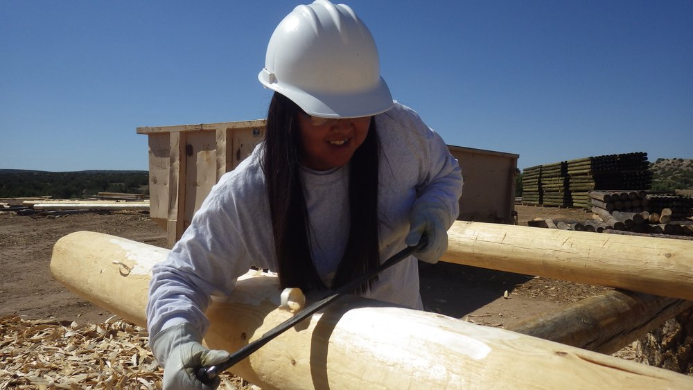 Forest Stewards Youth Corps member learns about a local timber company and gets hands-on experience peeling vigas. Corps members are employed from rural NM communities to work on conservation projects on public lands. Many of these youth go on to get degrees in natural resource management.
