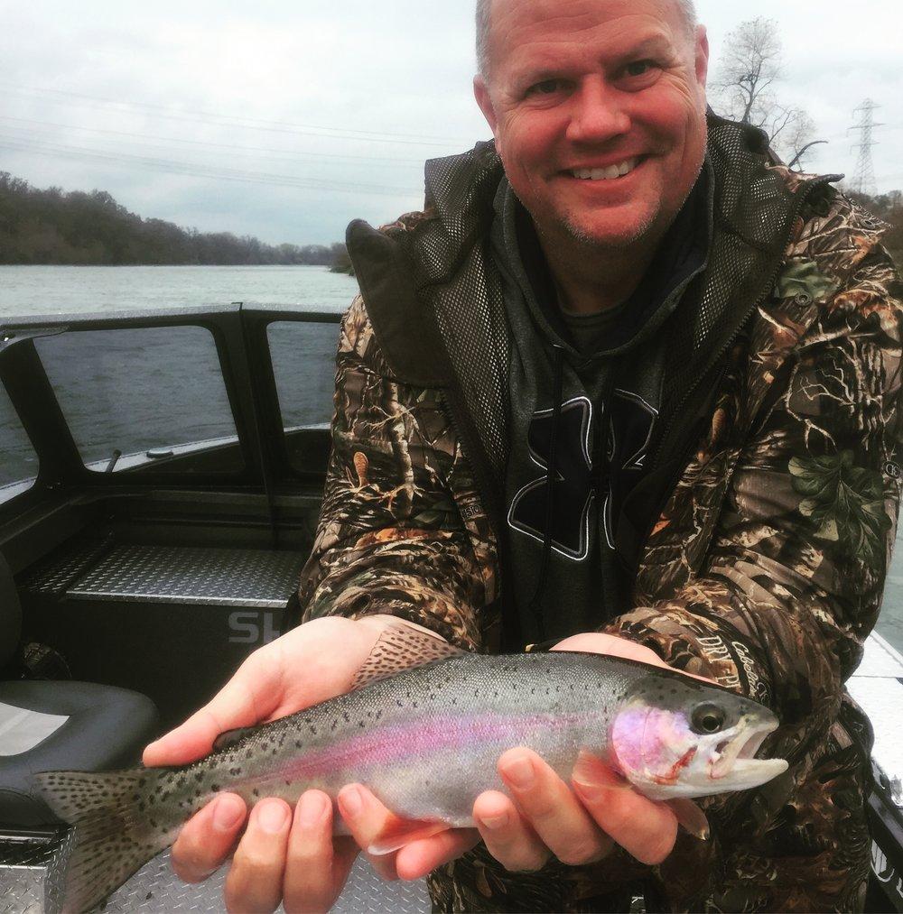 Chris Dugger of Redding, Ca. with a nice Sacramento River rainbow.