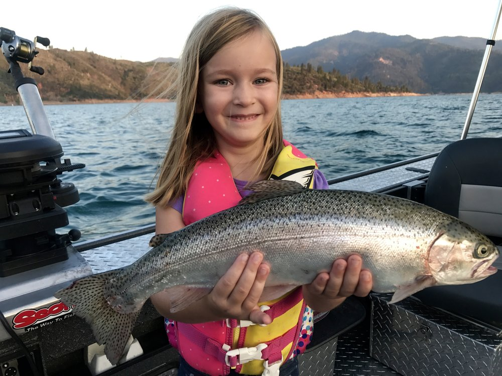 Gracie showing off one of her Shasta Lake rainbows she caught this week!