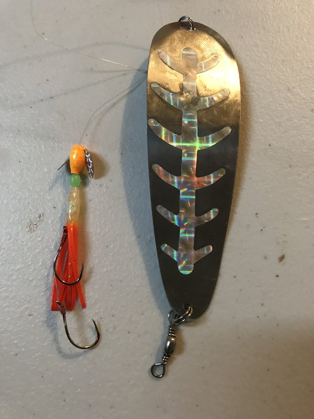 "This rig has been deadly lately.  Try a Mack's Lure Smile Blade in front of the small hoochie as well as I really like them.  Try different color Mack's Lure 4"" dodgers, especially in the UV colors for great results."
