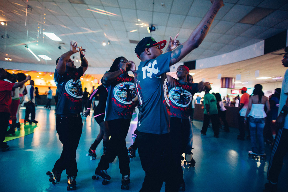 "Ohio skate crew, the ""Trend$ettas"", show out during national skate party, Detroit Soul Skate. Bonaventure Family Skating Center. Farmington Hills, Michigan"