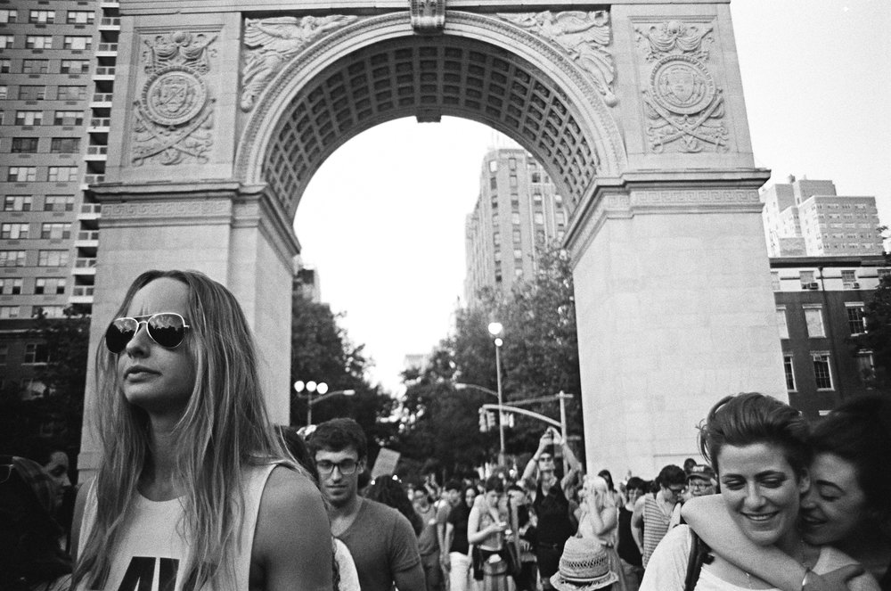 A couple embraces while entering Washington Square Park, the final stop of NYC's Dyke March