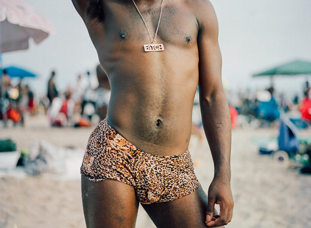 Man poses during Black Gay Pride celebration at Jacob Riis Park.