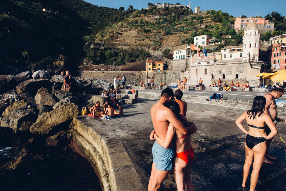 A couple embraces in Vernazza, Italy.