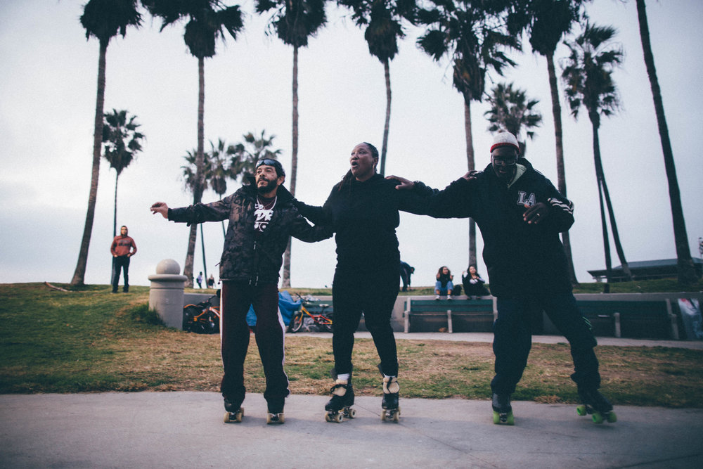 Nelson, Charlie and Richard perform a skate routine at the Venice Beach Skate Circle. Venice Beach, California.