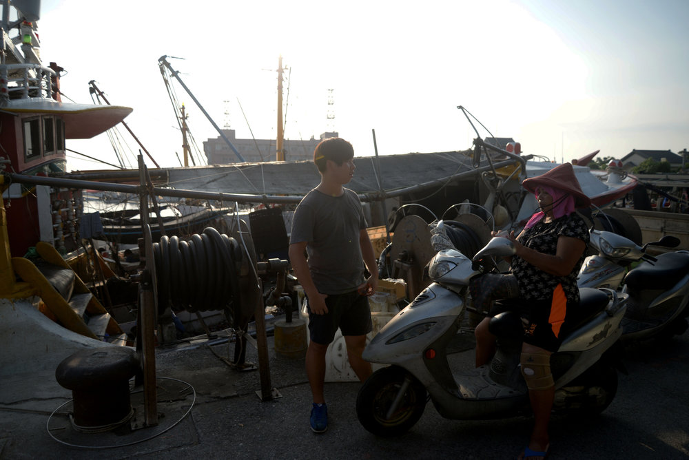 Wei Jeng Tzeng says goodbye to his mother at the docks of Fisherman's Wharf in Dansui, Taiwan on July 26, 2016. Wei is the heir of大陸妹 (Mainland Sister), a shrimping boat.