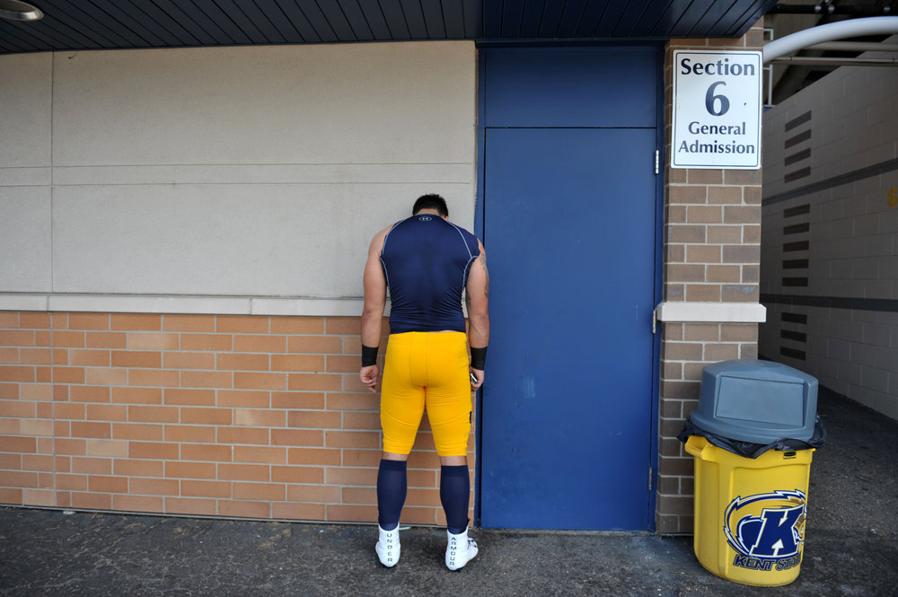 Kent State sophomore defensive end Alex Hoag takes a private moment outside the locker room before the home opener game Saturday, September 9, 2017 (Keown   UCM).