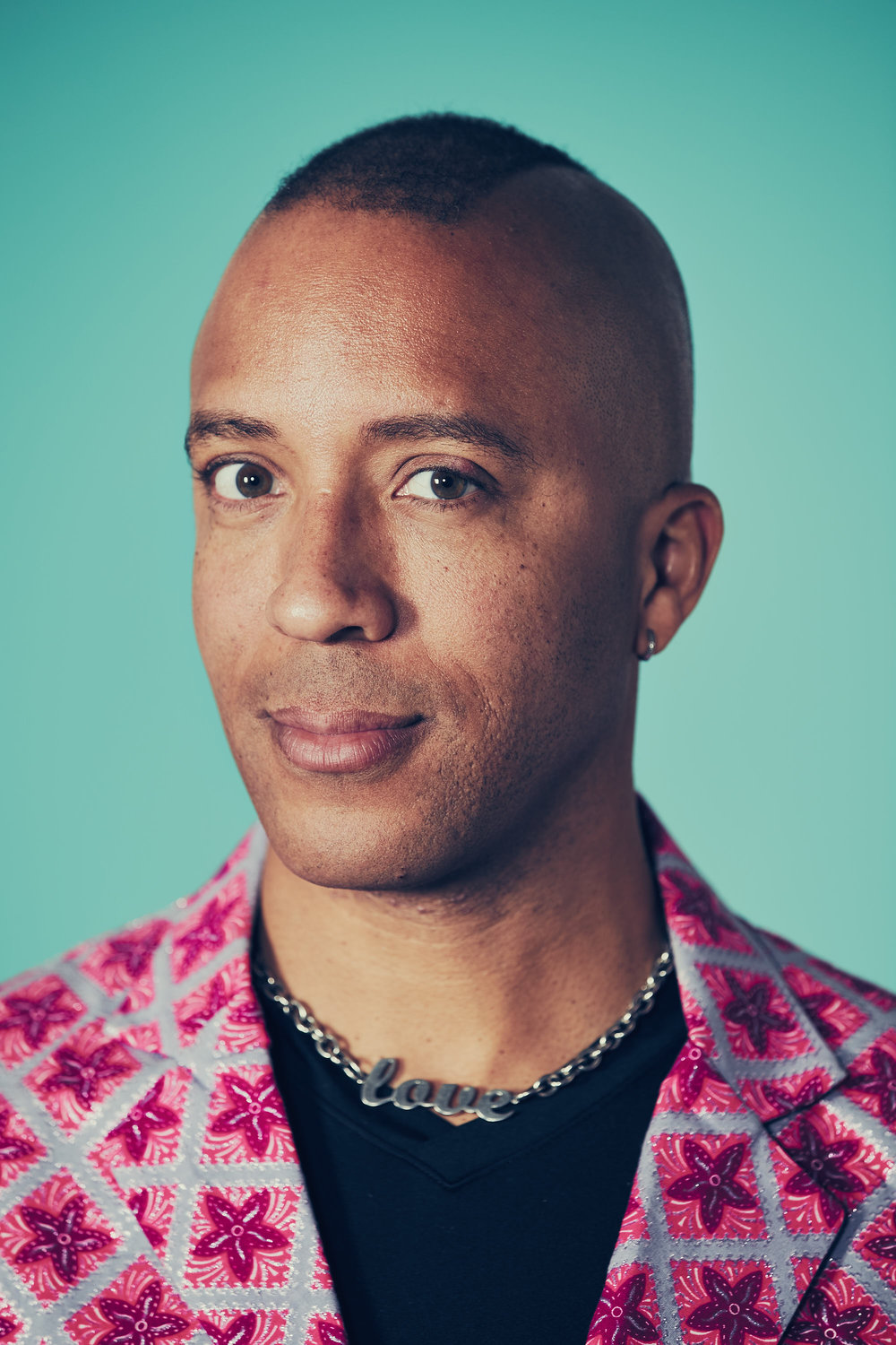 "Troy Jackson stands at the intersection of his identities, he is an Afro-Indigenous, Gay, Muslim, Performer, Writer and Host. His work has been shown at the AGO (Art Gallery of Ontario), The Inside Out Film Festival and TIFF (Toronto International Film Festival). He  is one of the co-owners of the oldest LGBTQ bookshop on the planet, The Glad Day Bookshop.  He co-founded the El-Tawhid Juma Circle in 2007, taking on President responsibilities in 2010.  Jackson sites Black liberation theology as the foundation of why he wanted manifestETJC, he states that ""nobody should be sitting at the ""Back of the Bus"" unless they like the view from back there"" Jackson believes that all should be treated as equals in life and in ritual prayer without apology."