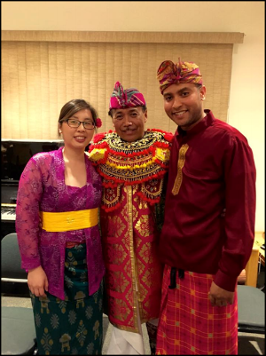Derrick Spiva Jr. (right) and his wife Kim Tran (left) with their Balinese gamelan gong kebyar teacher, I Nyoman Wenten (center), after a performance in 2016.