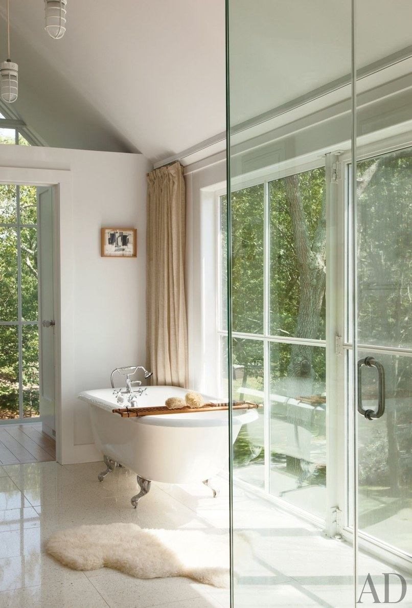 In Knoll CEO Andrew Cogan's Shelter Island, New York, home, the master bath features a cast-iron tub with fittings by Sign of the Crab.  Photo: Roger Davies
