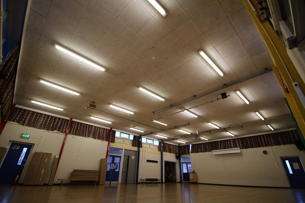 School Hall with faded diffusers and poor lighting spread