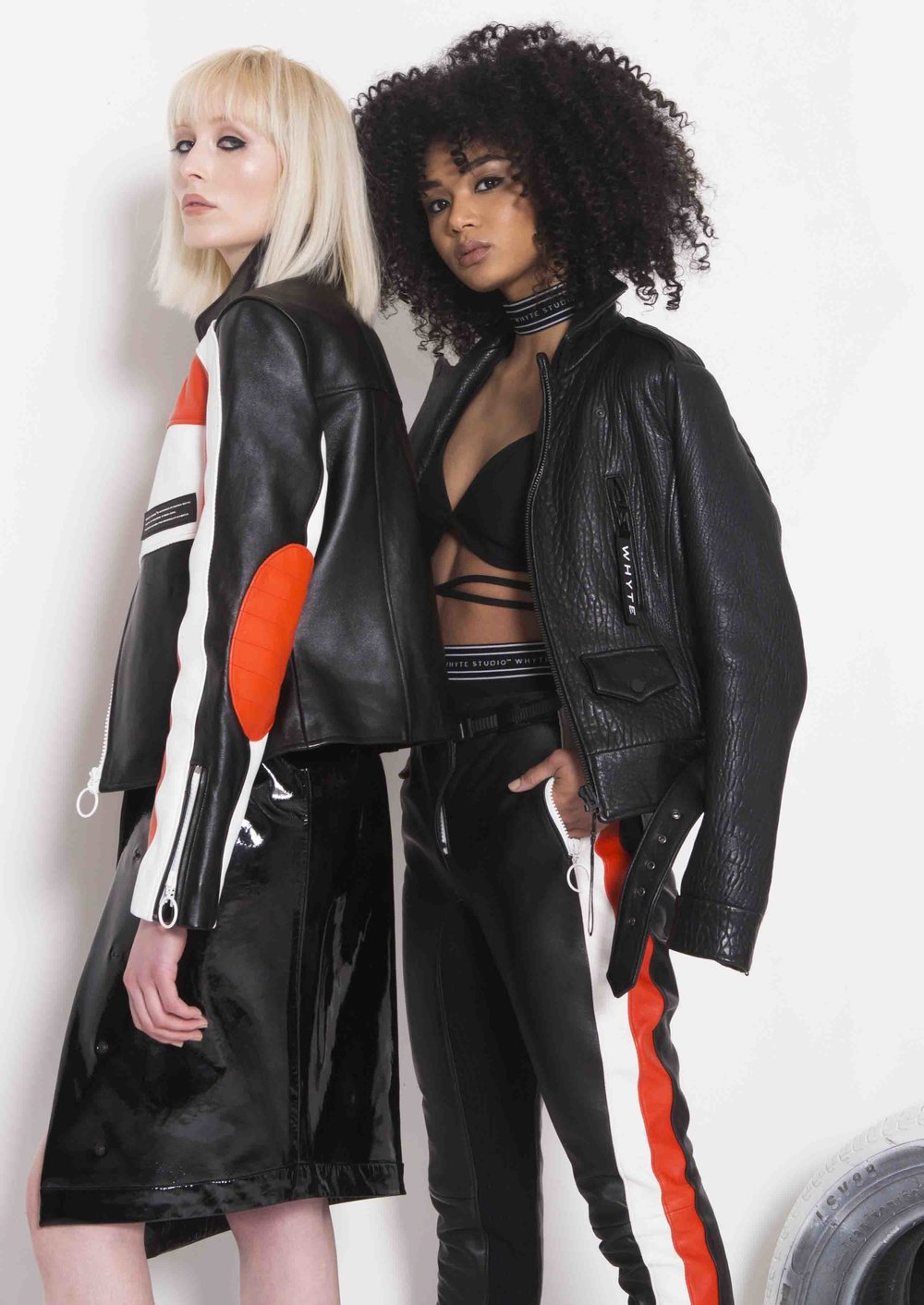 "WS1822002_THE ""REFORMED"" LEATHER JACKET 49 WS18SS208_THE ""SLATE"" TRIANGLE LACE UP TOP WS18AW002_THE ""SPEEDWAY"" MOTO TROUSER WS18AW016_THE ""SPEEDWAY"" MOTO JACKET WS18AW306_THE ""MX"" PATENT SKIRT_WHYTE STUDIO .jpg"