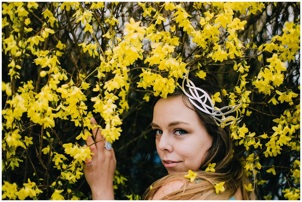 11 a.m.: Meeting up with Vanessa from  Wild Empress . We were originally planning to shoot her at a thrift store, but this giant hedge of forsythia needed to be photographed, Luckakuck Way.