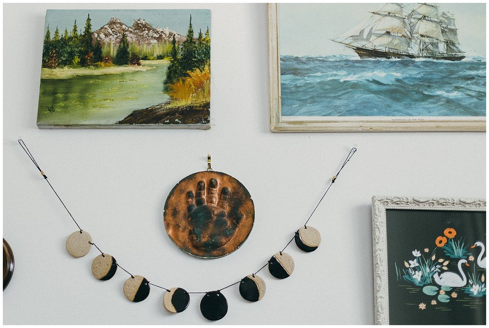 I think I picked up that sweet little painting at a market, the ship from Spruce Collective, the lunar garland from Fern Craftwork, the swans from Rifle Paper Co, and that sweet little copper handprint is actually my brother Brad's.