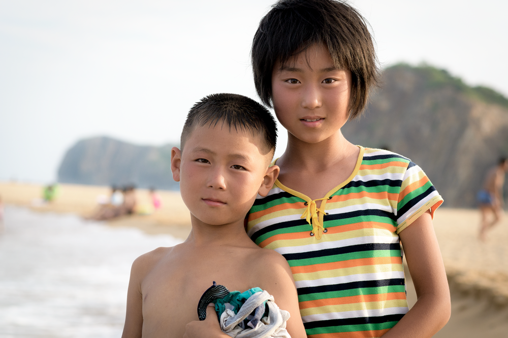 Interacting with some of the local children at Majon beach, North Korea.