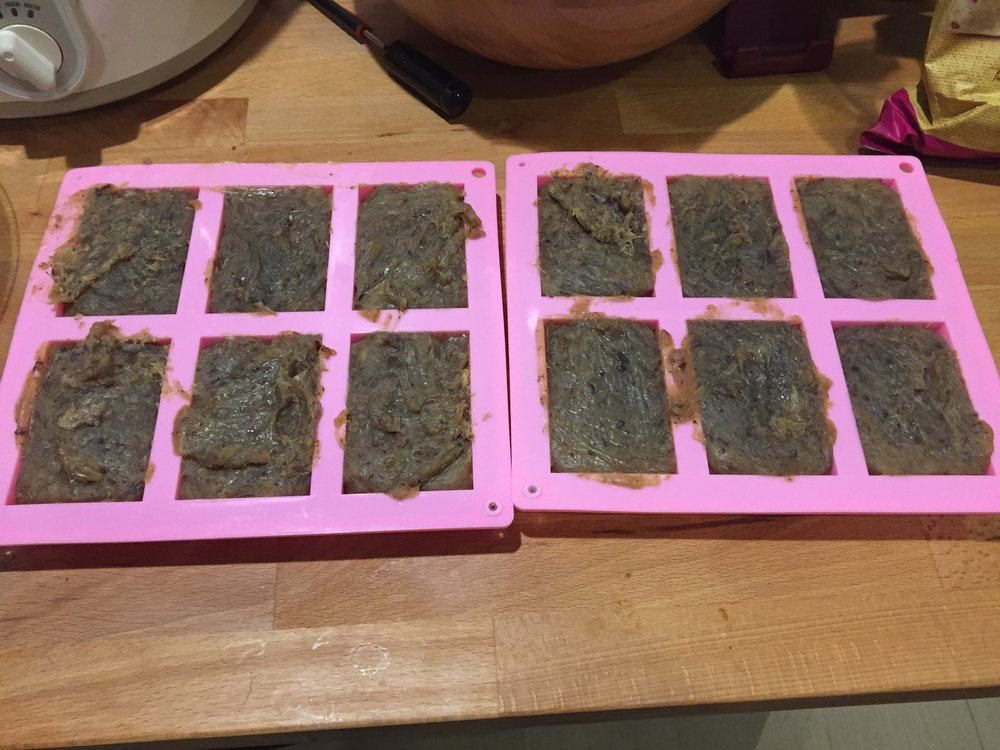 "The last step is to transfer the soap into a silicon mould to cool for at least two days.  The color of this batch is actually darker than the photo above since they are different batches - one with a saison and no spent grain above and one with Centennial IPA and spent grain below.  This batch produced 12 bars that are roughly 3"" x 5""."