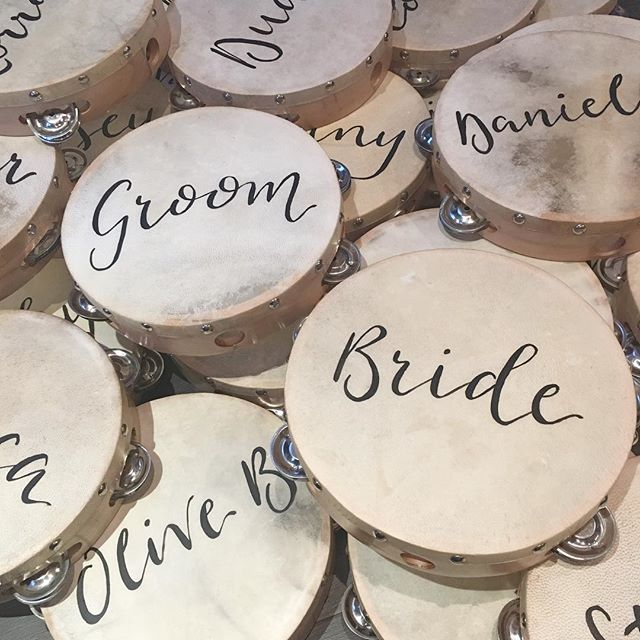 Tambourine place names 🎶 when the bride asks, can you write on anything... #placenames #placements #tambourine #tambourineplacename #wedding #tambourinewedding #bride #groom