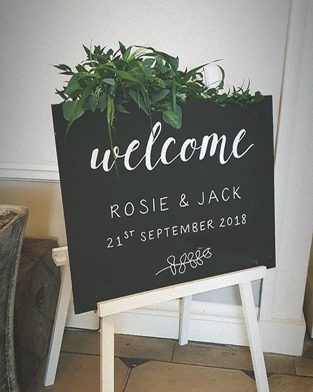 Happy wedding day Rosie & Jack 🌿 the flowers and foliage really bring this sign to life - thank you @darlingbudsdevon 💕