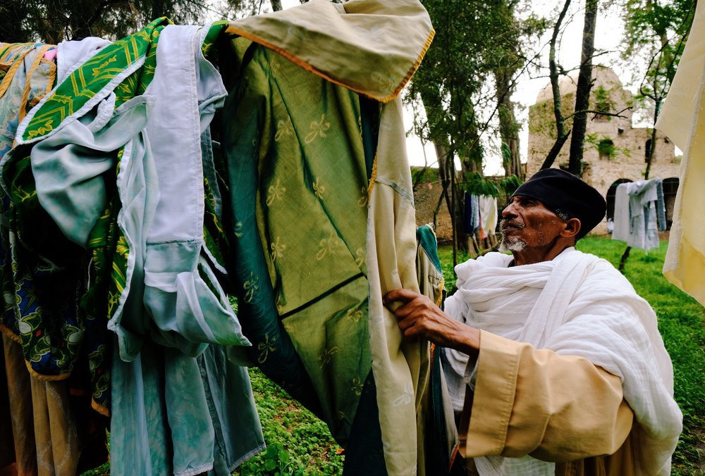 Monk hanging laundry in Gondar, Ethiopia by Joost Bastmeijer.jpeg