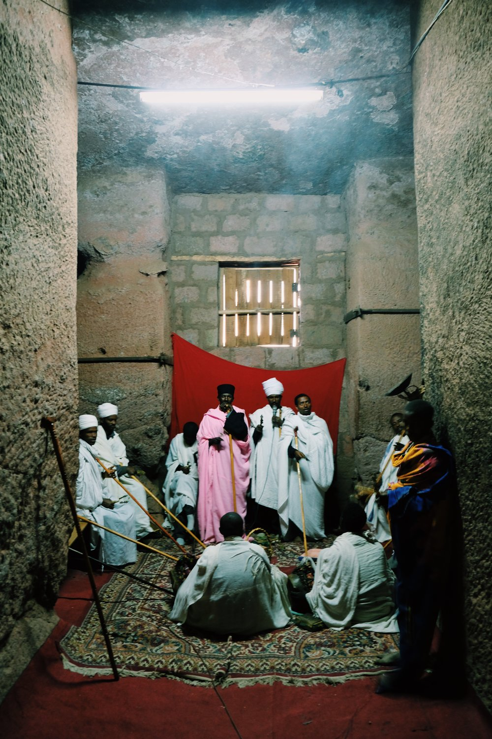 Priest and Monks chanting in Lalibela, Ethiopia by Joost Bastmeijer.jpeg