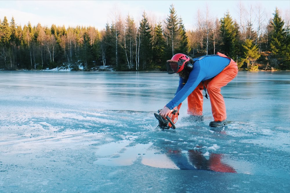 Ice cutting in lake Norway by Joost Bastmeijer.jpeg