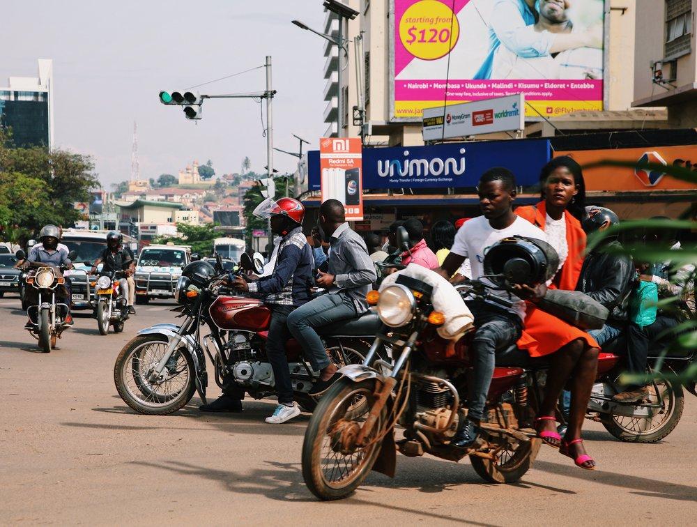 Kampala boda boda traffic by Joost Bastmeijer.JPG