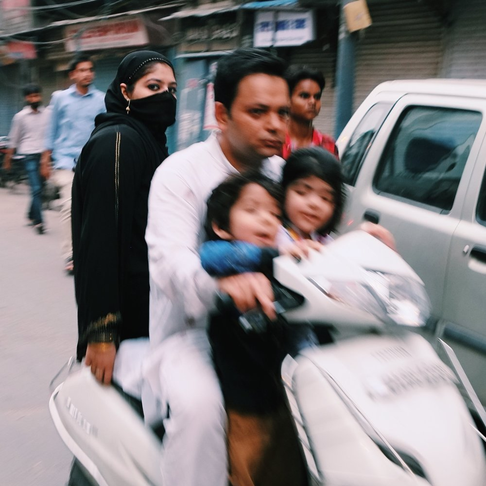 A family drives to the Friday Mosque of New Delhi, India.jpeg