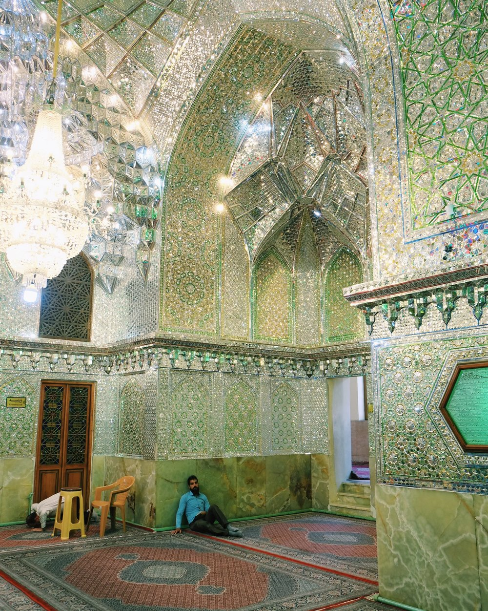 A man rests in an Esfahan mosque, Iran.jpg