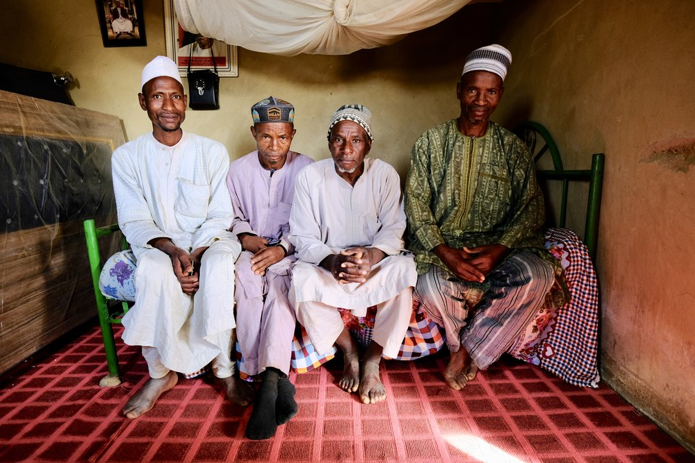 Fulani elders sit in a Plateau home.jpg