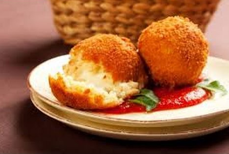 Delicious Sicilian street foods included Arancini - crumb coated, deep fried risotto and cheese balls!