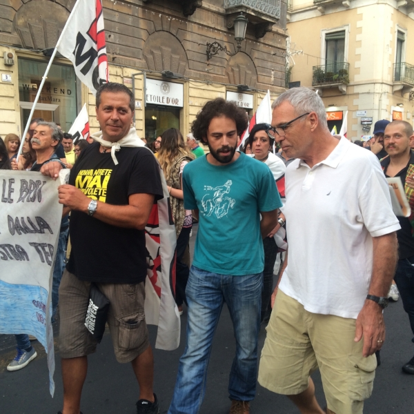 Michael finding out just what we are protesting as we joined the march in Catania, Sicily.