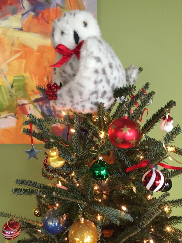 A real Christmas tree with a few of my own ornaments and an owl that landed at Kelly's house.