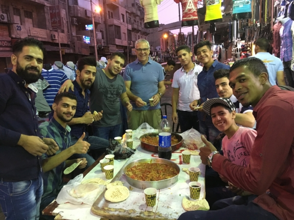 Joining the boys for an Iftar feast on the street in old town Amman.