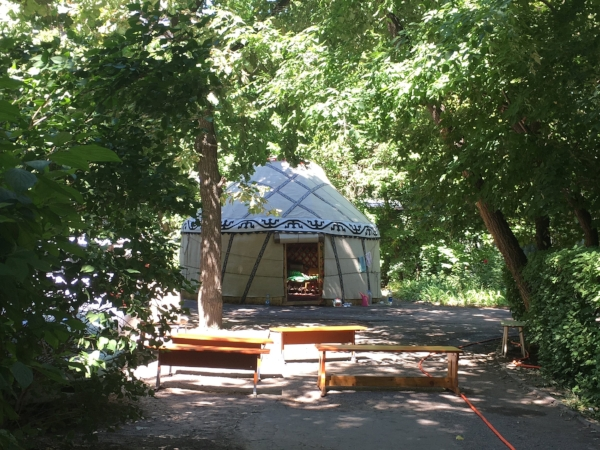 Here is the yurt that sat in our parking lot for three days of mourning for someone who lived (and died) in our building. Sometimes the benches were full women waiting to go inside and see the body and cry loudly. Men had to stay outside and smoke and be serious.
