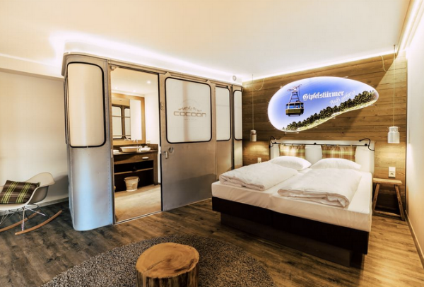 """One of the unique """"ski lodge"""" themed rooms at the planet friendly Cocoon Hotel in Munich."""