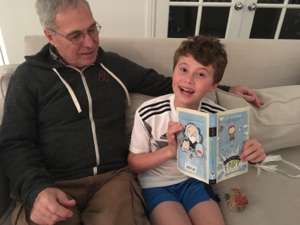 Grandpa Michael and Spencer sharing a book about magical Fart Powder - let the laughing begin!