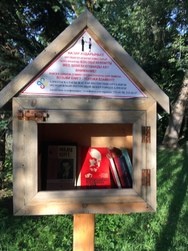 """We do come across """"little libraries"""" in our travels like this one in Almaty, Kazakhstan, However, we don't often score a """"must read""""."""
