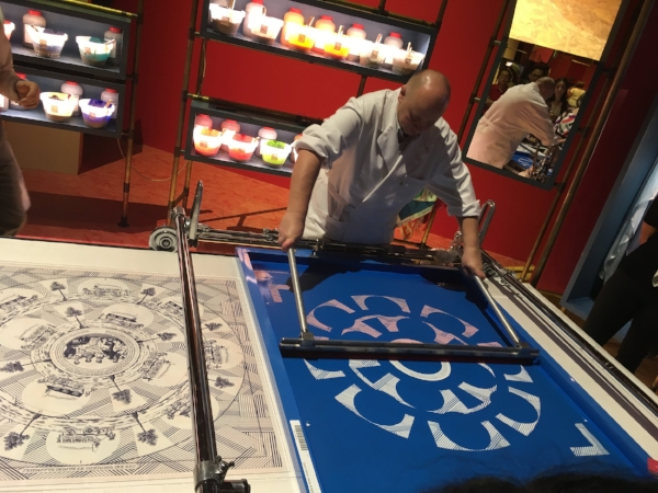 We learned it takes two years from inception to completion to create a Hermes scarf. Here an artist adds the second of 18 different colors to the silk on this complex design.