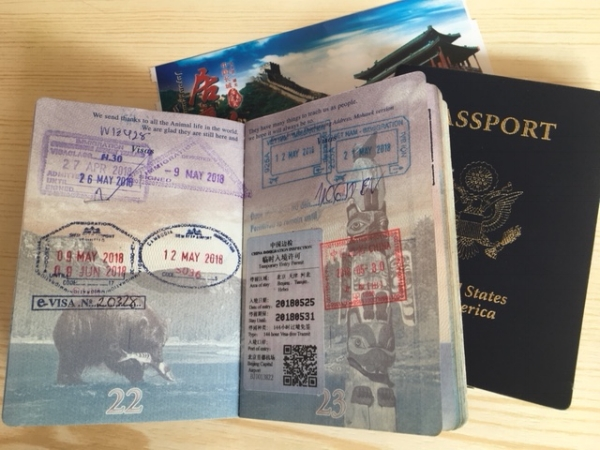 Our 144-hour visas were pasted in our passports. Just missing the registration stamp!