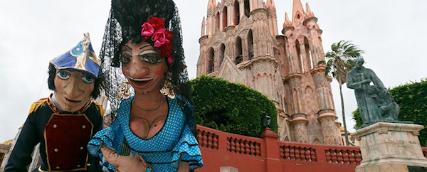 Sit on a bench in El Jardin for a while and you'll collect all kinds of new friends. Including giant paper mache Mojigangas!