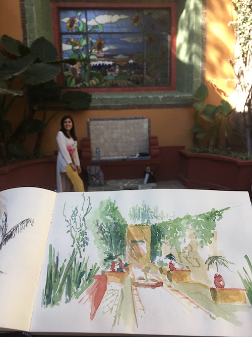 I am holding one of Pau's sketches she dashed off in the botanical gardens with her in the background. My work was getting closer to this level of spontaneous beauty - but I'll need a bit more practice before I post my efforts.