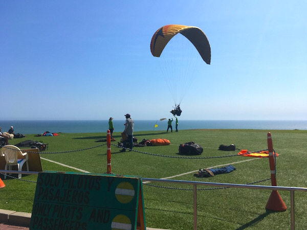"""We were fascinated by the paragliders leaping off the cliff into the late afternoon wind. On our last day I decided I'd """"go for it"""" and take a tandem ride for my birthday - but there wasn't enough wind. Darn?"""