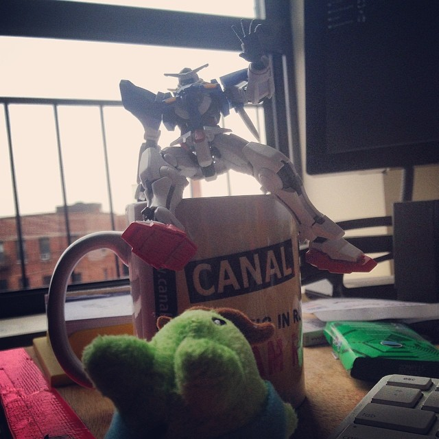 I leave my desk for 5 minutes and bunny starts chasing Gundam.. Real professional bunny.