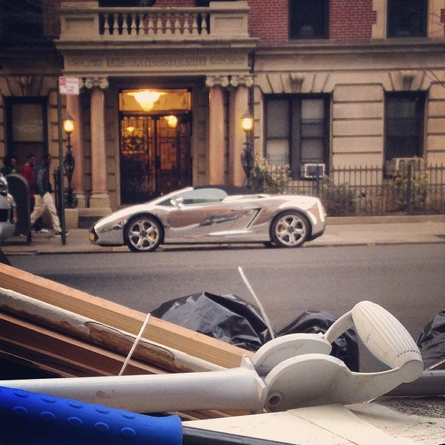 Chrome sports'd car and some trash.