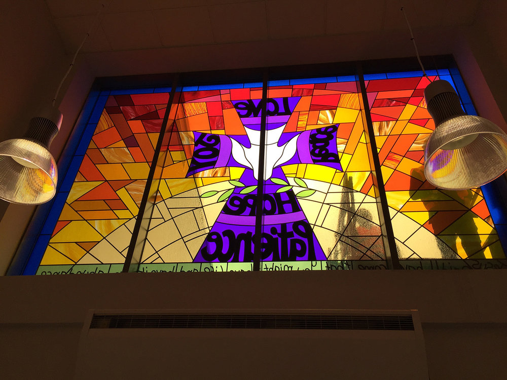 Cross and Sunburst Design School Entryway