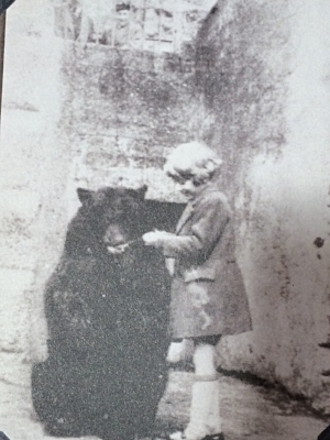 Winnie with Christopher Robin at the London Zoo from the album pages in Finding Winnie