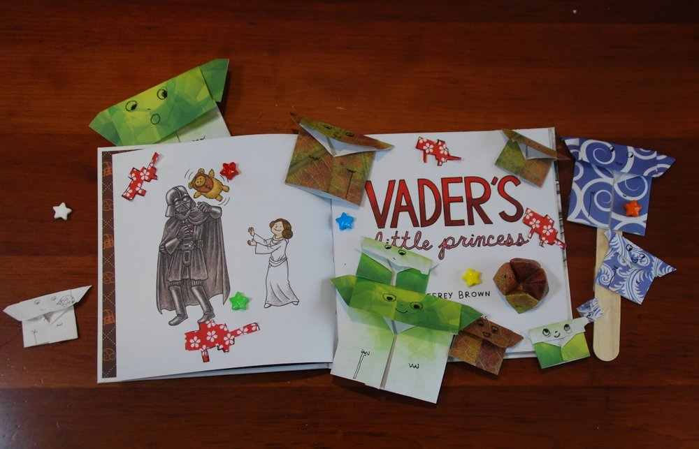 Our copy of  Vader's Little Princess  surrounded by Origami Yodas that the girls made for my top secret project.  Little Lion even made those red blasters!  Thumbprint pic above is of LL with one of her besties. Both pictures posted with permission.