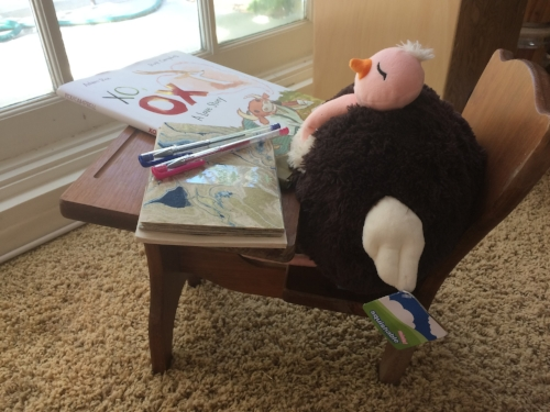 Mini Me's Ostrich contemplating who to write a letter to. PLOP (Plump Little Ostrich Pal) is using Papersource stationery and was inspired by Ox from  xo, ox  by Adam Rex. This school desk is one of several handmade by Mr. Bookworm's parents. #notanad #butwelovePLOP and #squishables.