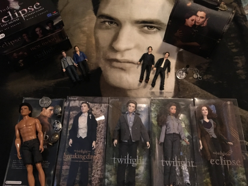 My sister-in-law's Twilight collection.  Why is Jake the only one out of the box, K?  Is he not worth as much?  Also, I didn't realize that the last one was Victoria.  Her hair isn't red enough.  I thought it was supposed to be Esme.
