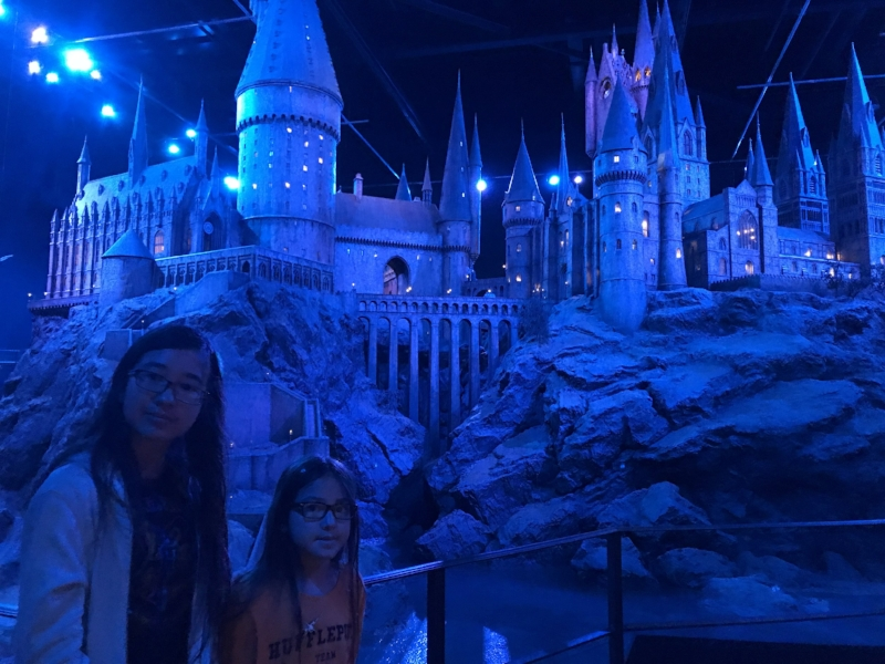 The Bookworm Girls in front of the scale model of Hogwarts at Warner Brothers Studios in London. Posted with permission of my girls.